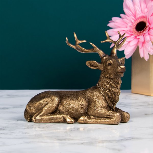 RELFECTIONS BRONZED LYING STAG